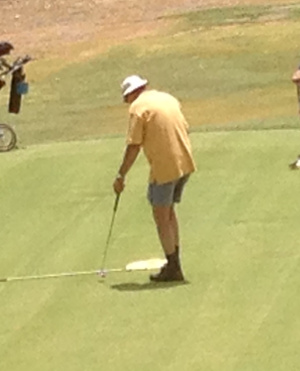 Dick Secomb completes his round.