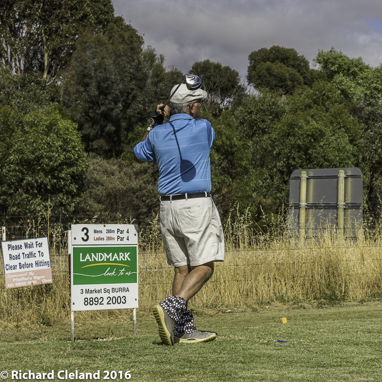 Dick Cleland lets one go on the third tee.
